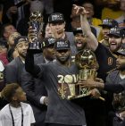 Cleveland Cavaliers forward LeBron James, center, celebrates with teammates after Game 7 of basketball's NBA Finals against the Golden State Warriors in Oakland, Calif., Sunday, June 19, 2016. The Cavaliers won 93-89. (AP Photo/Eric Risberg)