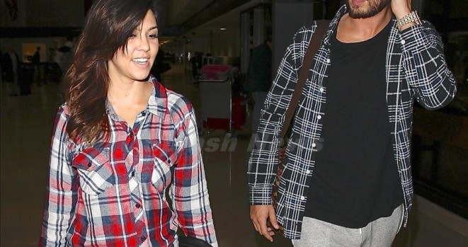 Kourtney Kardashian and Scott Disick were seen arriving on a flight at LAX