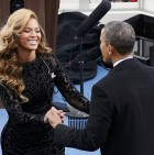 Singer Clarkson is kissed by U.S. President Obama after her performance during inauguration ceremonies in Washington