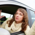 Angry young woman sitting in a car